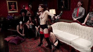 Alice Illustrate and Audrey Holiday are among the subs at a BDSM party